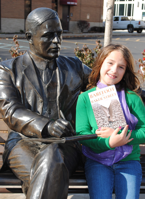 "Many thanks to Leah Guinn who sent in this lovely picture of Barefoot with a statue of Max Ehrmann, a Terre Haute, Indiana native who wrote the famous poem, ""Desiderata."" He's sitting at the corner of US Highway 40 (the National Road), and US 41, or the old ""Dixie Highway"" (which connects Chicago and Miami, Florida). Mr. Ehrmann liked to sit out at this corner to people watch, write and, apparently, read about Sherlock Holmes."